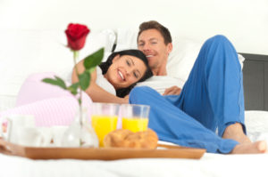 Romantic couple having breakfast in bed